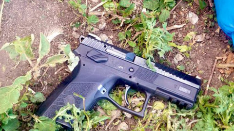 Pistol recovered from the scene. PHOTO/COURTESY