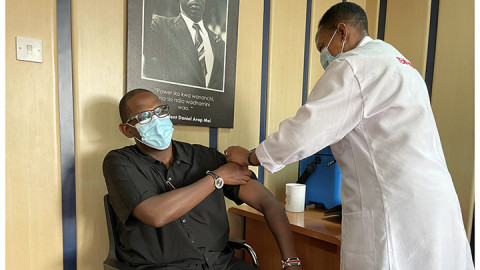 Nzioka Waita getting vaccinated. PHOTO/COURTESY