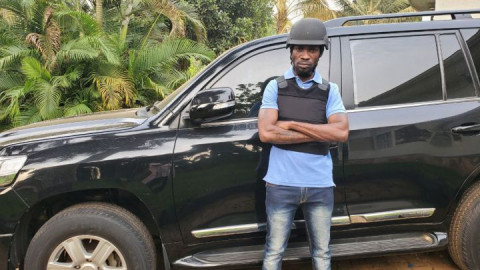 Bobi Wine and his armoured vehicle.