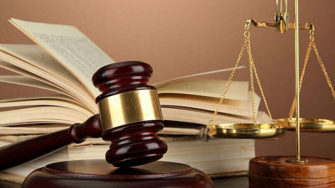 A gavel, a balance scale and an open book. PHOTO/COURTESY