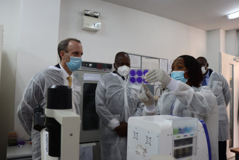 Dominic Raab, Muthai Kabwe and a Scientist. PHOTO/COURTESY